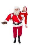 圣诞老人和克劳斯夫人微笑对照相机的 库存图片