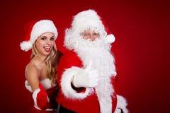 圣诞老人和惊人的圣诞节女孩 免版税图库摄影