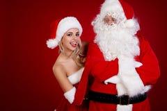 圣诞老人和惊人的圣诞节女孩 库存图片