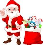 圣诞老人和礼品 库存图片