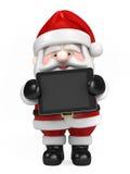 圣诞老人和藏品片剂 图库摄影
