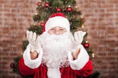 圣诞老人和降雪 免版税库存图片