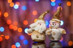 圣诞老人和雪人 免版税库存图片