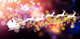 圣诞老人和驯鹿剪影的综合图象  免版税图库摄影