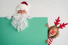 圣诞老人和驯鹿孩子 免版税库存图片