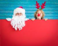 圣诞老人和驯鹿孩子 库存照片