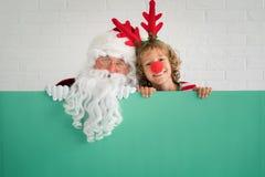圣诞老人和驯鹿孩子 库存图片