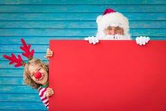 圣诞老人和驯鹿孩子 免版税图库摄影