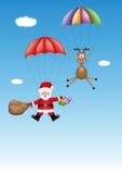 圣诞老人和驯鹿来临与礼物 库存照片