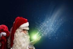圣诞老人和魔术 免版税库存图片