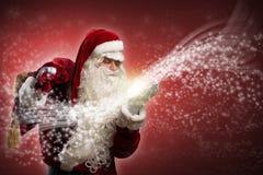圣诞老人和魔术 库存照片