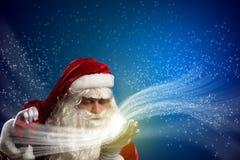 圣诞老人和魔术 库存图片