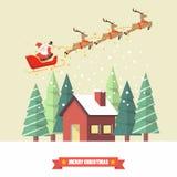 圣诞老人和他的驯鹿雪橇与冬天房子 库存图片