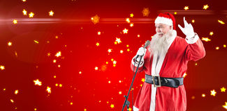 圣诞老人唱歌圣诞节歌曲的综合图象 免版税库存图片