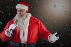 圣诞老人唱歌歌曲的综合图象 库存图片
