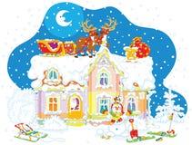 圣诞老人圣诞节爬犁在屋顶的 库存照片