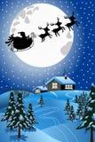 圣诞老人圣诞节雪撬或雪橇飞行在晚上 免版税库存图片