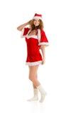 圣诞老人在圣诞节的女孩姿势穿戴全长 库存图片