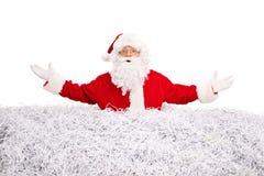 圣诞老人在堆黏附了切细的纸 免版税库存照片