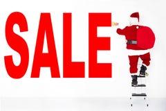 圣诞老人在墙壁上的绘画销售 免版税库存图片