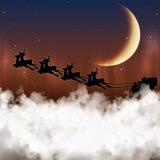 圣诞老人在月亮的背景飞行 免版税库存照片