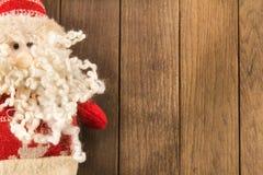 圣诞老人在木背景的圣诞节装饰 免版税库存图片