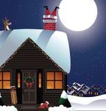 圣诞老人在烟囱停留 免版税库存图片