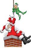 圣诞老人在烟囱被困住 免版税库存照片