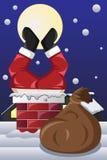 圣诞老人在烟囱黏附了 免版税图库摄影