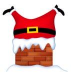 圣诞老人在烟囱黏附了 图库摄影