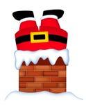 圣诞老人在烟囱黏附了 免版税库存图片