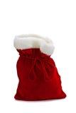 圣诞老人在空白背景的礼品袋子 库存照片