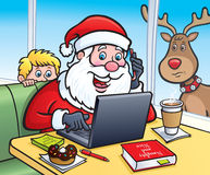 圣诞老人在膝上型计算机的一家咖啡店 免版税库存照片
