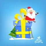 圣诞老人坐大新年礼物 向量,例证 库存照片