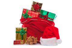 圣诞老人大袋礼品充分包裹了存在 免版税库存照片