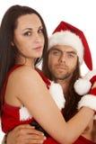 圣诞老人夫妇坐膝部关闭 库存照片