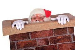 圣诞老人奋斗 免版税库存照片