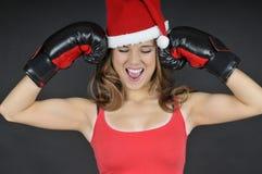 圣诞老人女孩佩带的拳击手套 免版税库存图片