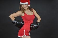 圣诞老人女孩佩带的拳击手套 免版税库存照片