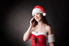 圣诞老人女孩发表演讲关于移动电话 免版税库存图片