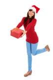 圣诞老人女孩和圣诞节礼物 免版税库存照片