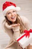 圣诞老人女孩和雪花 免版税库存图片