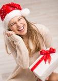 圣诞老人女孩和雪花 免版税图库摄影