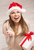 圣诞老人女孩和雪花 图库摄影