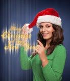 圣诞老人女孩愿望您一个愉快的圣诞节和新年 免版税库存照片