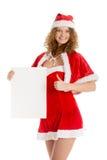 圣诞老人女孩拿着与赞许的白纸 库存照片
