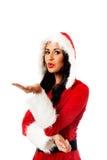 圣诞老人妇女吹的亲吻 库存图片