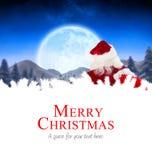 圣诞老人对村庄的交付礼物 免版税库存图片
