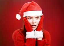 圣诞老人布料的愉快的女孩 库存照片