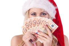圣诞老人帮手帽子的微笑的妇女有金钱的 库存图片